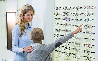 Child picking out glasses