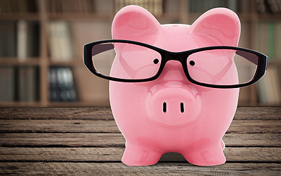 A piggy bank with glasses on