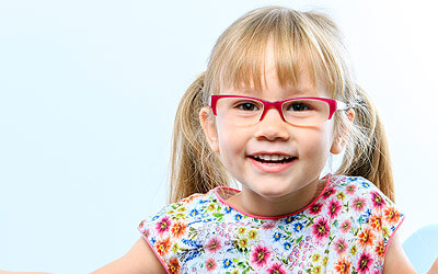 Girl child smiling with glasses on